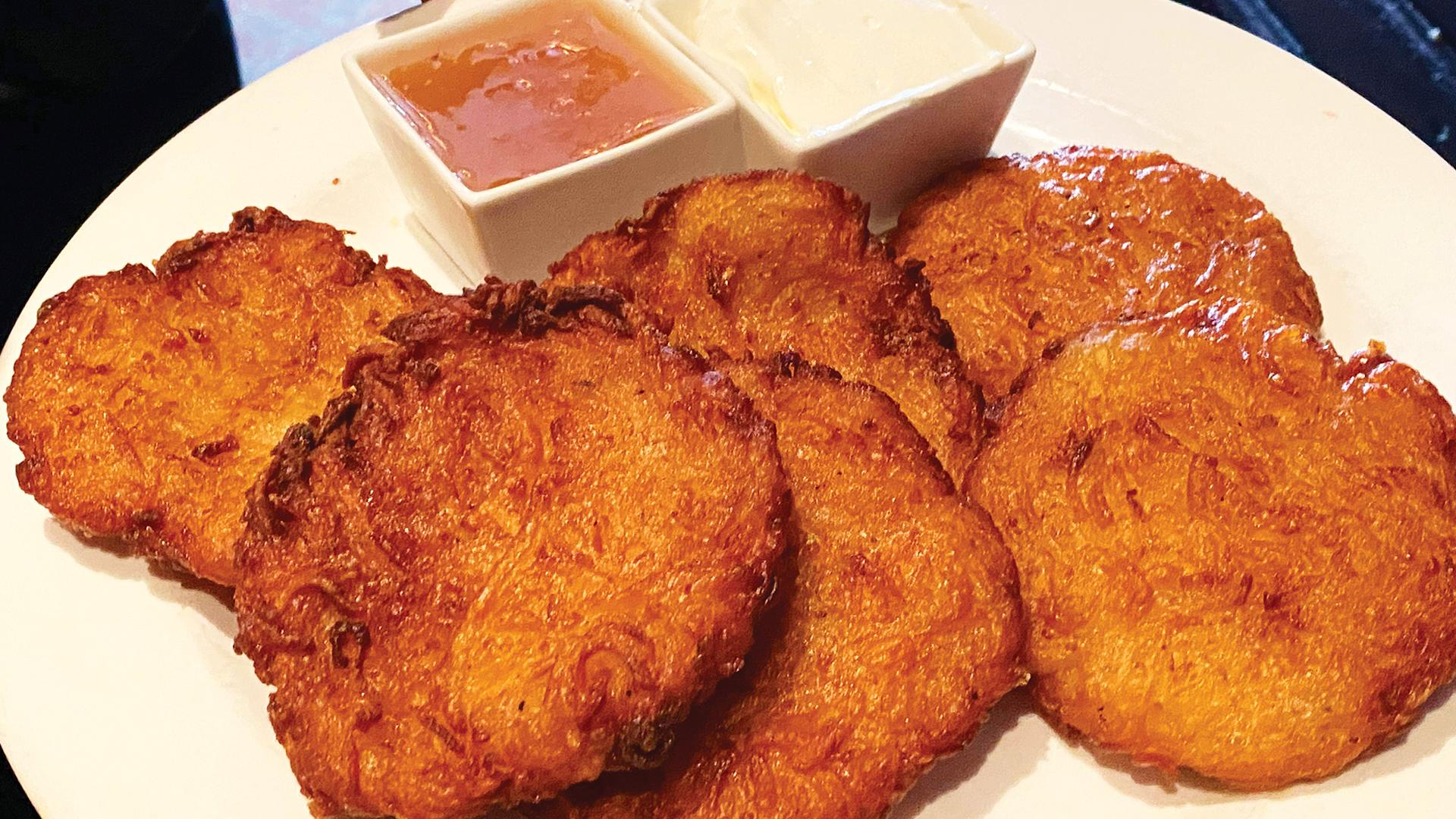 Toronto's best latkes | A plate of latkes with dips from Free Times Café