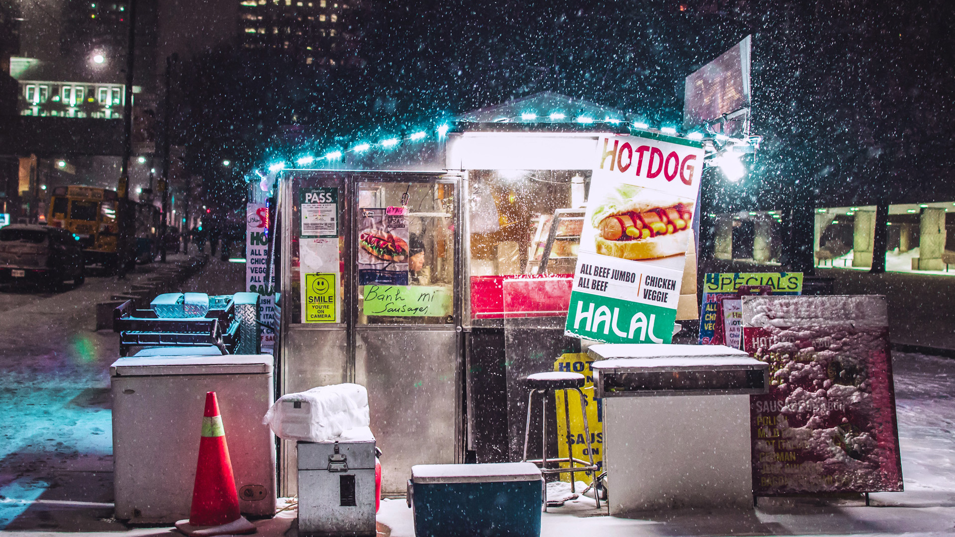 Things to do in Toronto this January 2021 | Snow falls on a hot dog stand beside Nathan Phillips Square