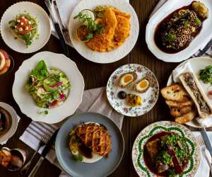 Restaurant Review: The Rabbit Hole, a whimsical British pub   A spread of British dishes at The Rabbit Hole