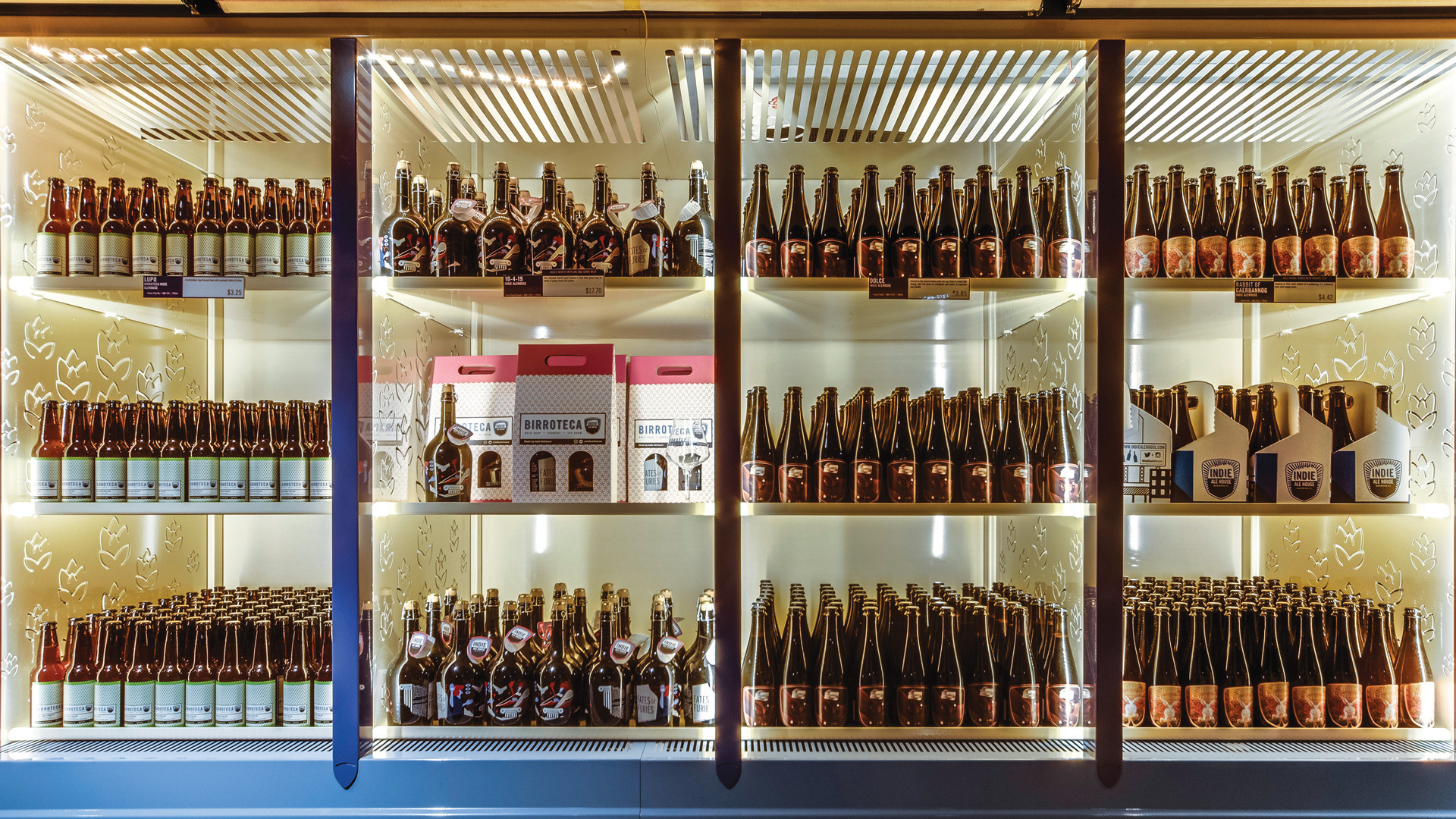Alcohol delivery in Toronto | A fridge stocked with beer at Birroteca, the brewery and bottleshop inside of Eataly in Toronto