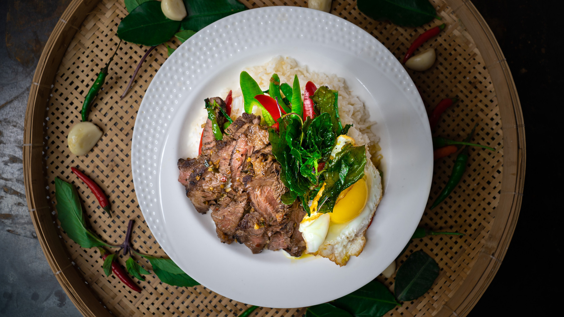 The best new restaurants in Toronto | Pad Ka Pao striploin with fried egg at Maya Bay