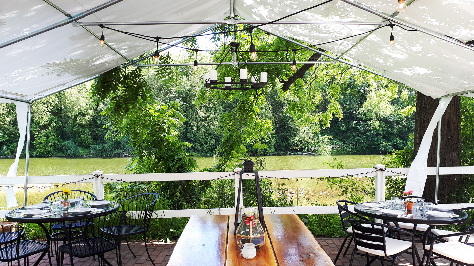 The patio overlooking the Grand River at La Fontana, one of the best Elora restaurants