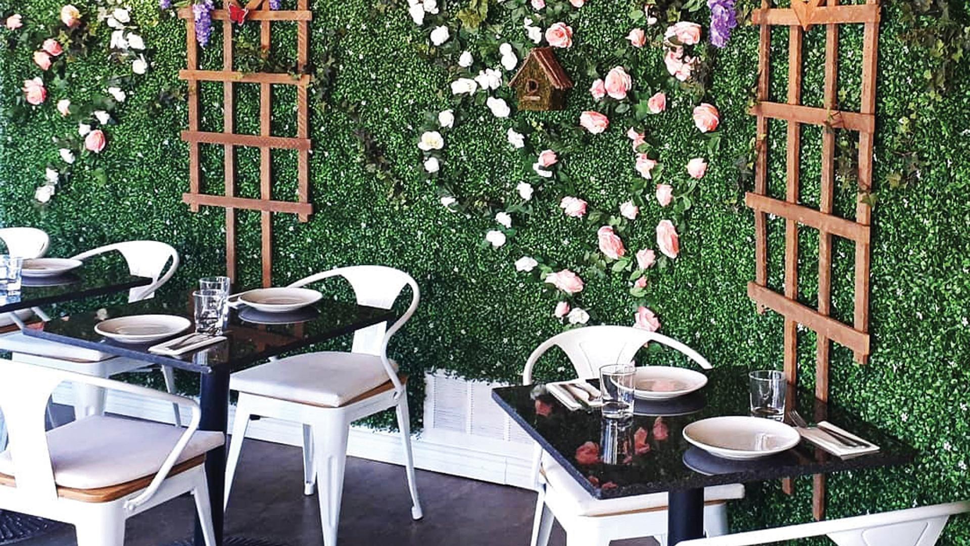 The flower wall inside La Fontana, one of the best Elora restaurants