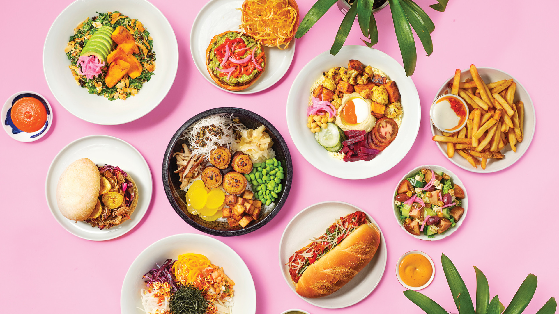 A spread of plant-based dishes from SweetChops, vegan food delivery in Toronto