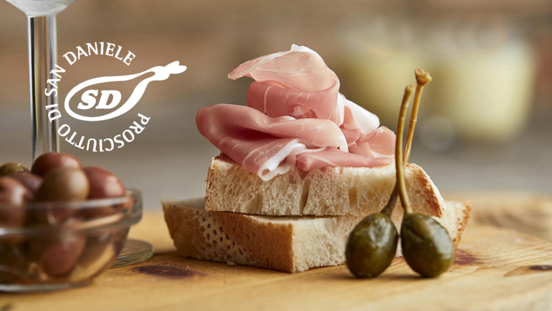 Prosciutto di San Daniele on bread with olives