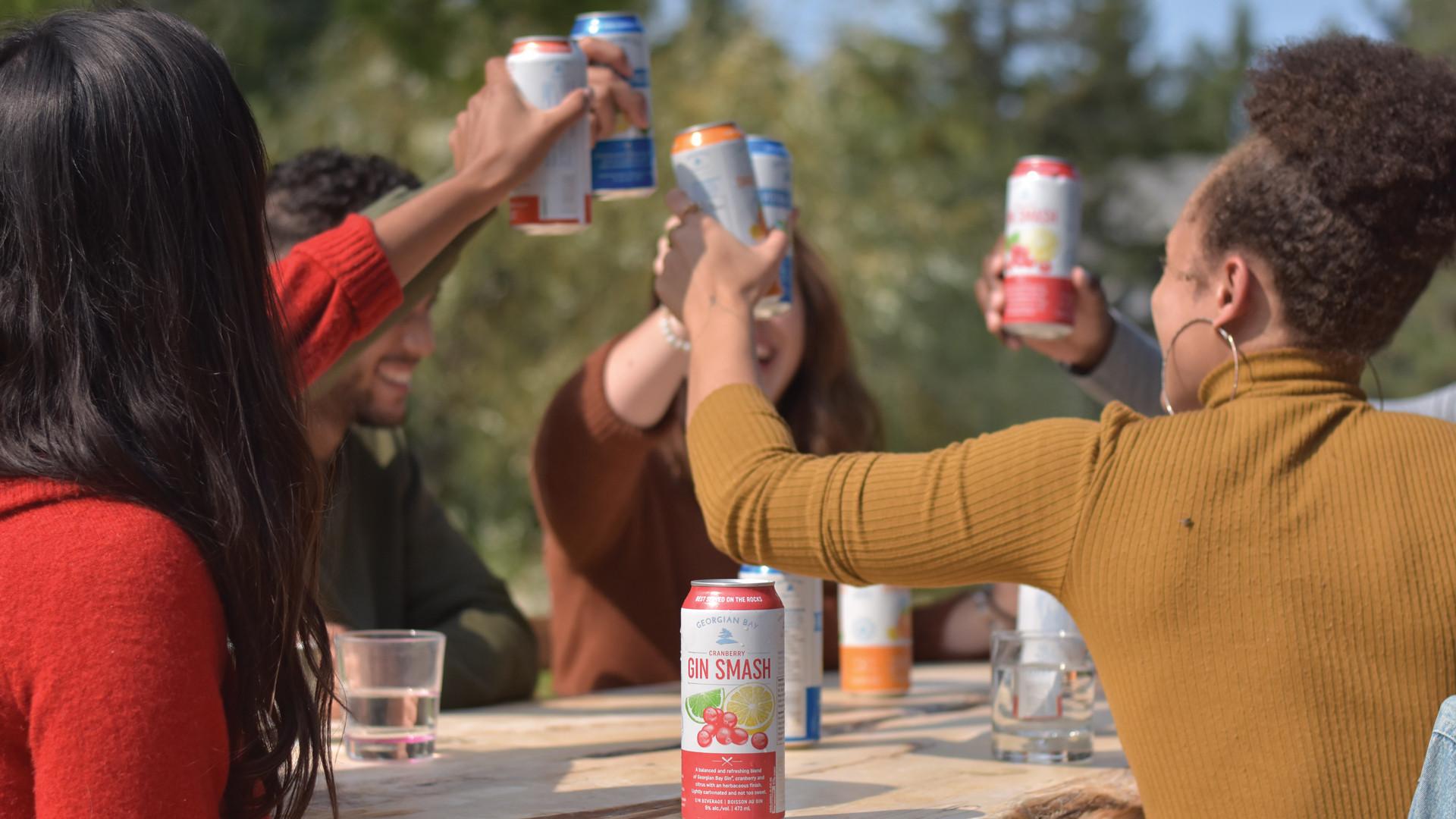 Win a smashing party pack from Georgian Bay Spirit Co. | Friends drinking Georgian Bay Gin Smashes