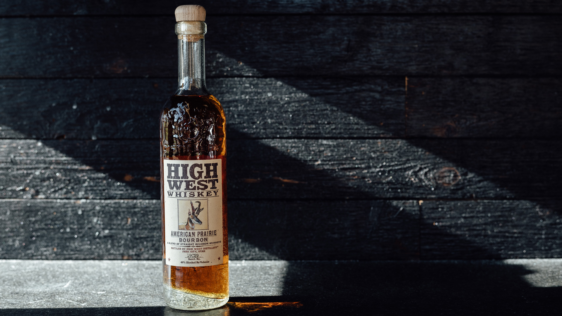 High West American craft whisky is now available at LCBO | A bottle of High West American Prairie Bourbon against a dark wood background