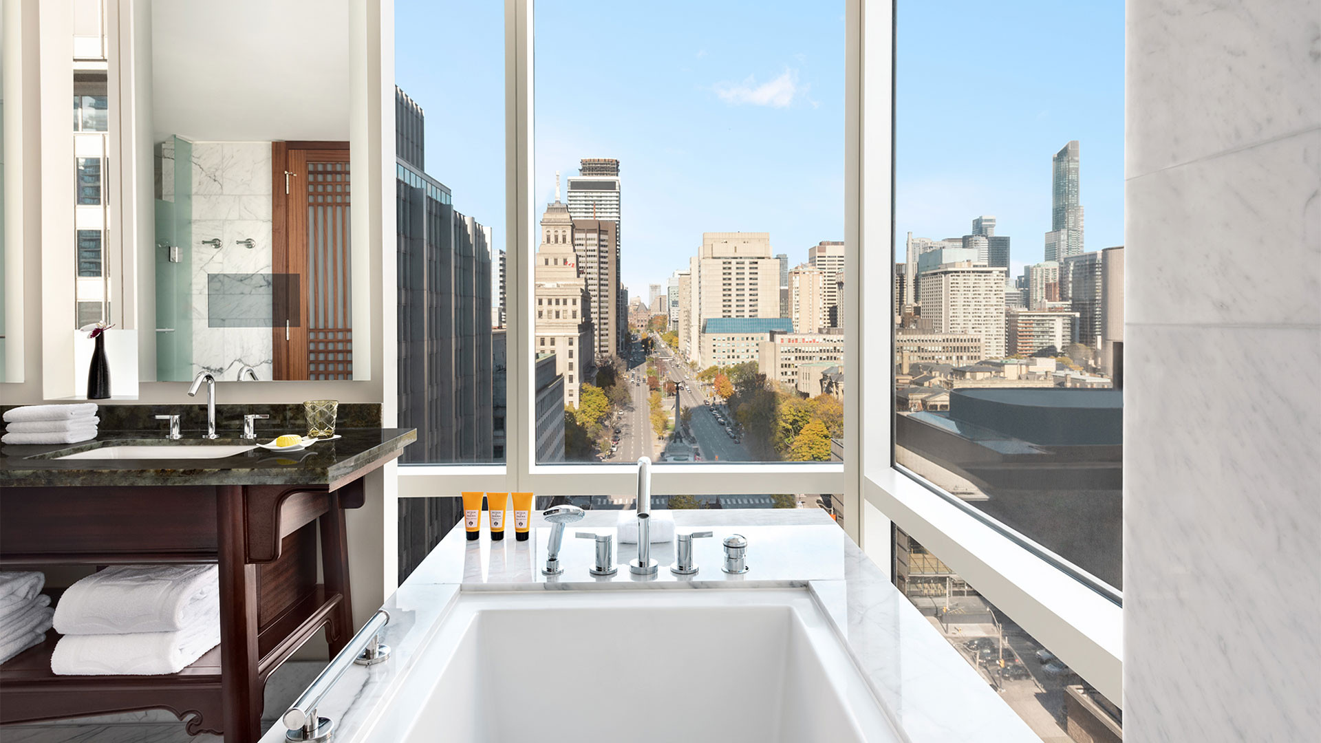 The best Toronto hotels for a staycation | The Shangri-La hotel bathtub overlooking University Ave.
