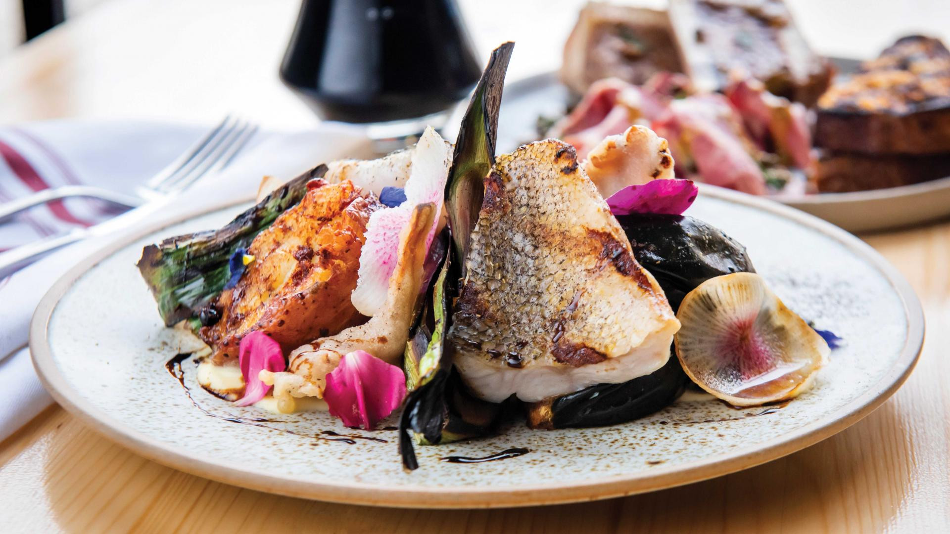 Restaurant supply chains: Seasonal grilled fish over warm salad at Bandit Brewery