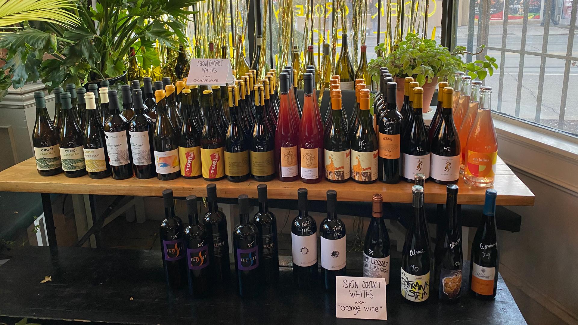 The best bottle shops in Toronto | A shelf of wine bottles at Midfield wine bar