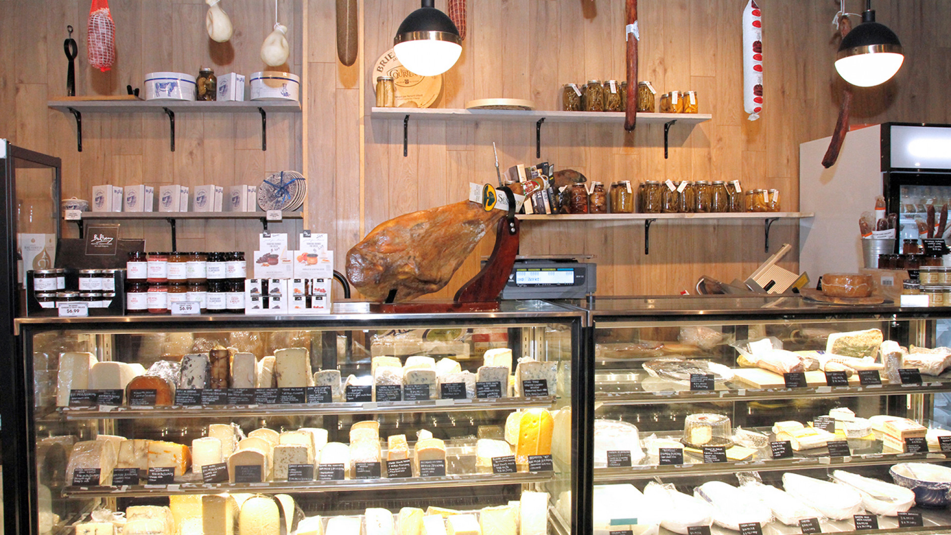 Unboxed Market, Zero waste grocery store and refillery | At the cheese counter, fill up your own container from home
