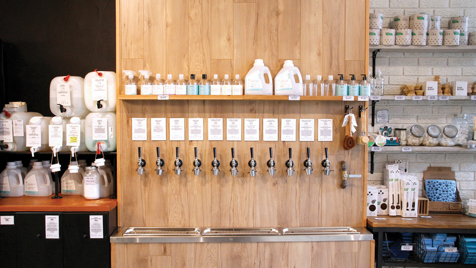 Trinity Bellwoods neighbourhood guide   A wall of household liquids on tap at Unboxed Market