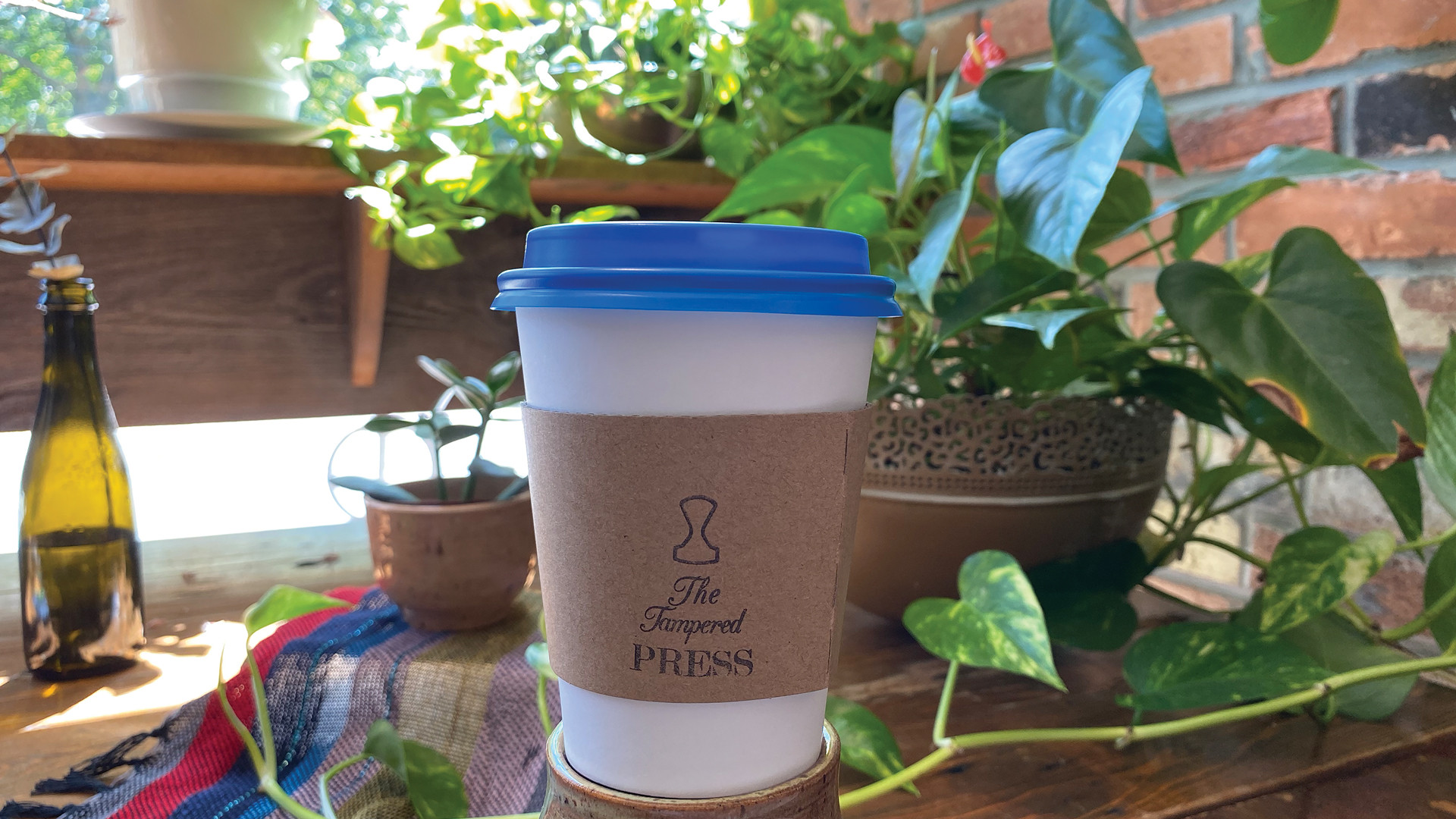 Trinity Bellwoods neighbourhood guide   A coffee cup inside The Tampered Press
