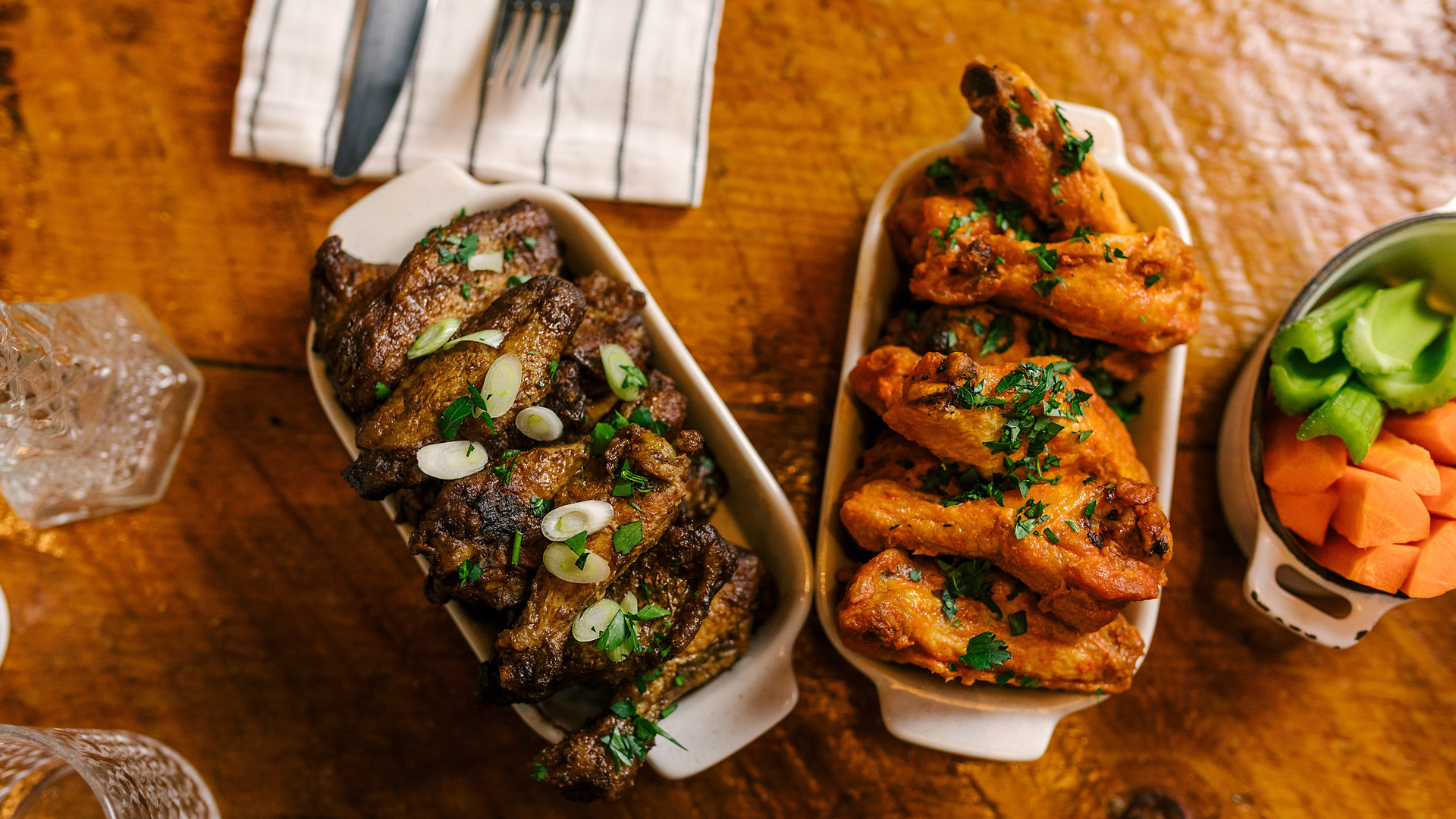 The best new restaurants in Toronto | Two different kinds of Betty's chicken wings at CoMMO Kitchen