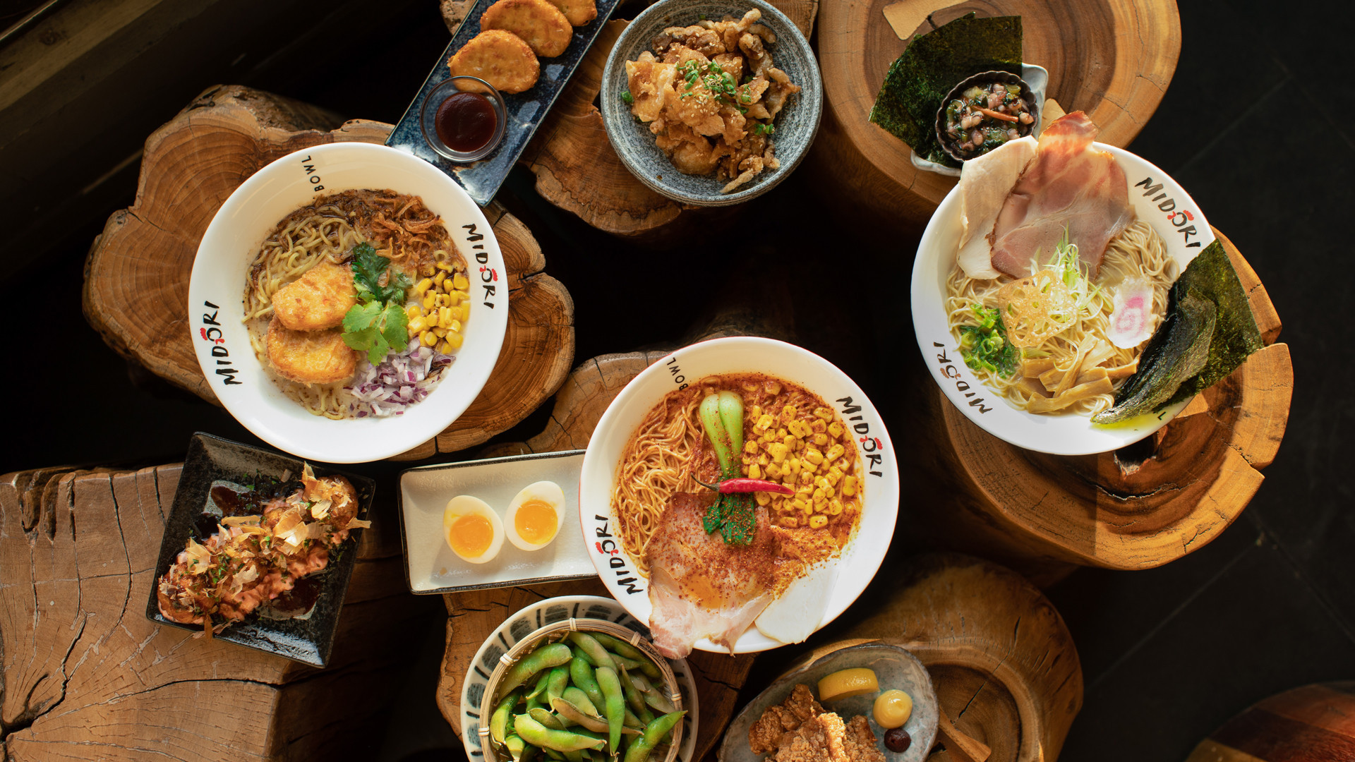 The best new restaurants in Toronto | A spread of ramen and other dishes at Midori