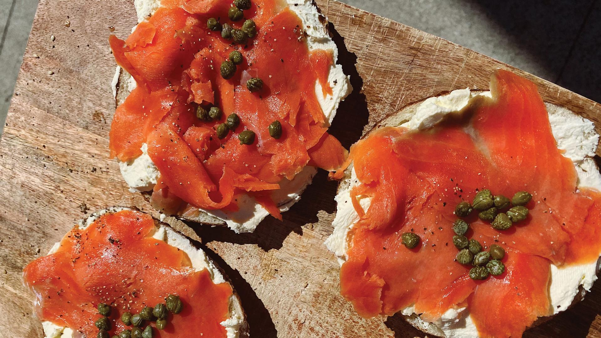 Safehouse Coffee, greengrocer, café, art shop and community hub | Salmon and lox bagels at Safehouse Coffee