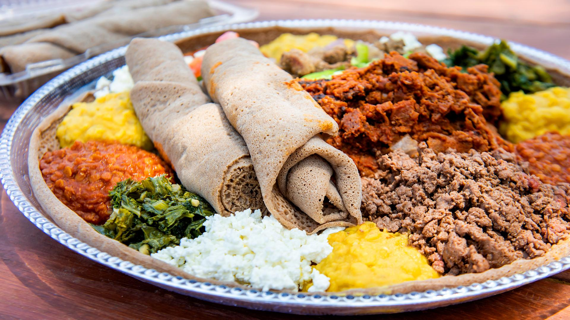 The best Toronto food markets   Injera with firfir, yemisir wat and other sauces at Market 707