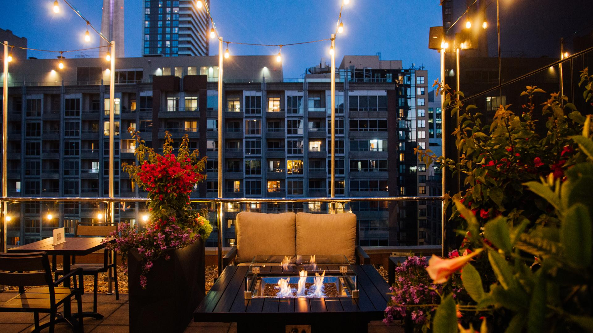 The best rooftop patios in Toronto | A warm fire pit on a cool night at Victor Rooftop Terrace