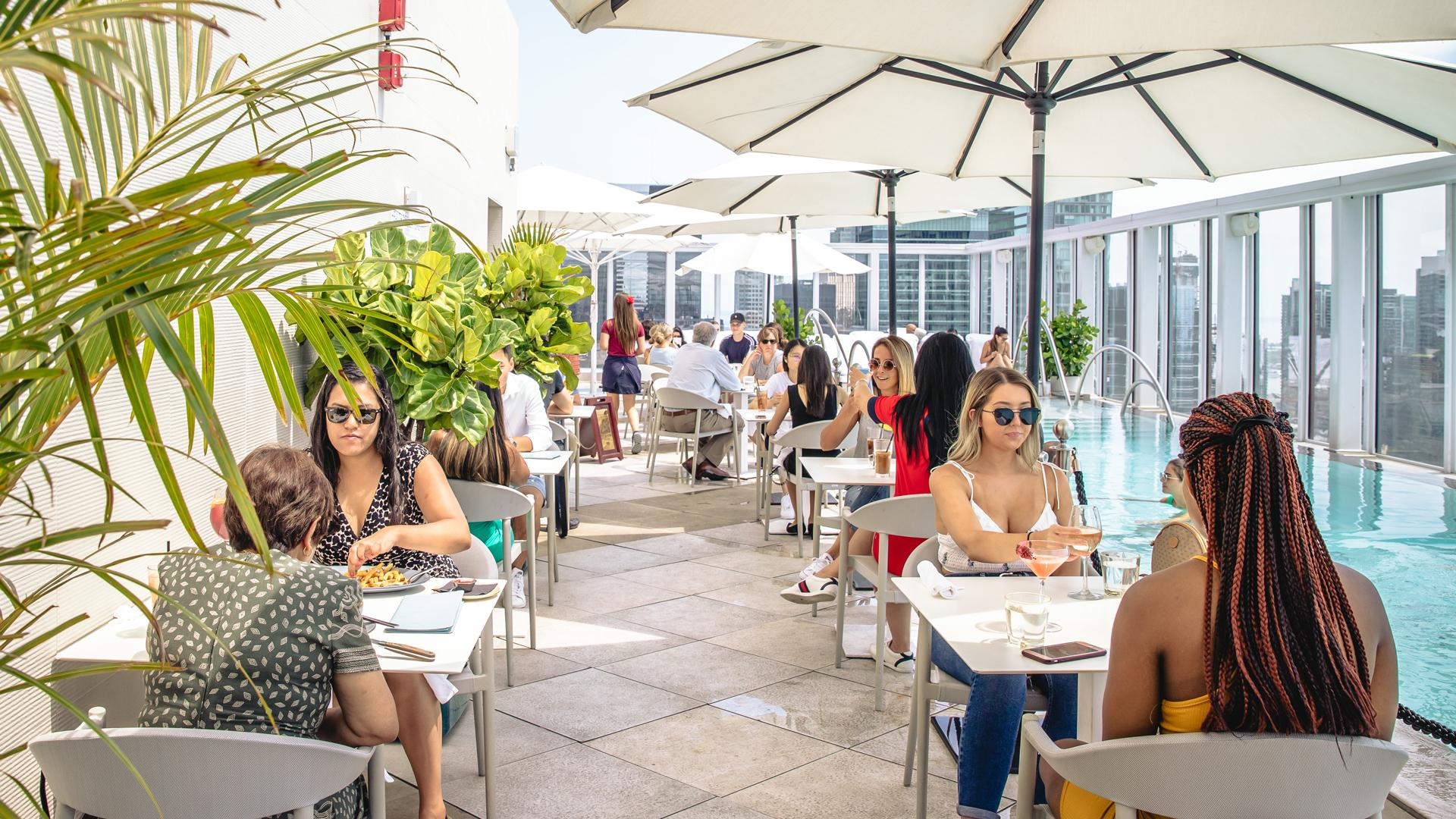 The best rooftop patios in Toronto | People dine on the rooftop patio at KOST