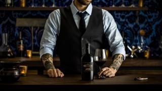 Three Finger Jack Cabernet Sauvignon   A bartender serves red wine