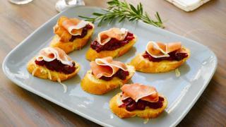 Italian appetizers: Prosciutto di Parma Cranberry Crostini