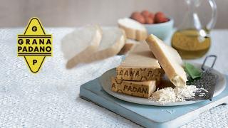 Grana Padano cheese shredded on a blue plate