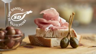 Prosciutto di San Daniele piled on a slice of bread