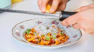 Toronto home cooks and their online food businesses | Jess Maiorano of Pasta Forever grating cheese over pasta