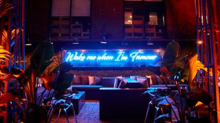 The best patios in Toronto | A neon sign lights up the patio at Xango