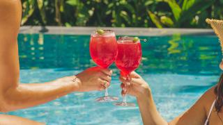 Picnic recipes | People cheers by the pool with two select spritzes