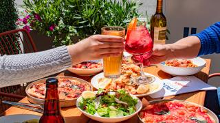 The best patios in Toronto | Two people cheers at Il Patio di Eataly with Aperol