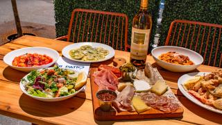 The best patios in Toronto | A spread of dishes at Il Patio di Eataly with Aperol