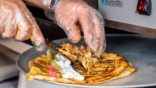 The best shawarma in Toronto   Preparing a chicken shawarma wrap at Chef Harwash