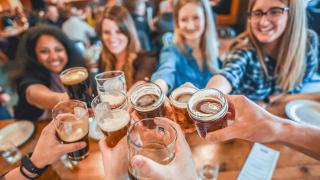 Celebrate International Beer Day with American craft beer   A group celebrating with pints