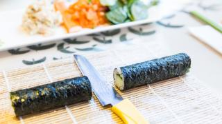 Places offering cool cooking classes in Toronto | A sushi roll being made in a class