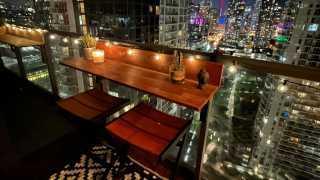 Win an acacia wood Views Balcony Bar | A Views Balcony Bar at night