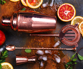 Cocktail recipes and tips from Toronto's best bartenders | A rose gold shaker, strainer and stir spoon surrounded by fruit