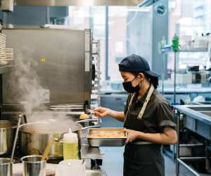 Toronto restaurant industry recovery | Someone works in the kitchen at Ascari on King