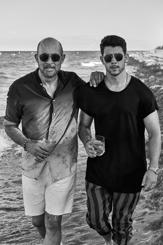 John Varvatos and Nick Jonas sipping Villa One Tequila on a beach