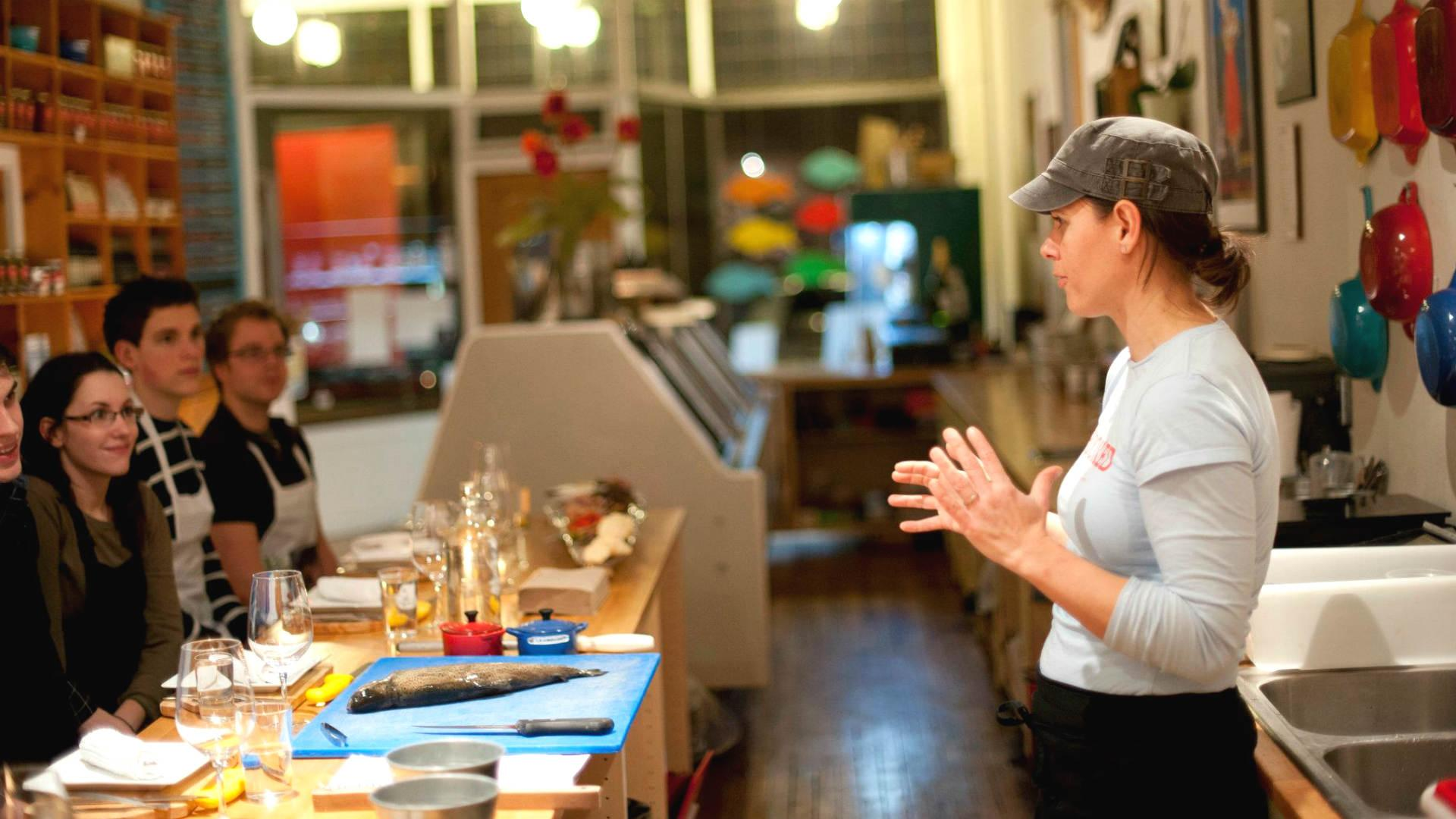 Places offering cool cooking classes in Toronto | Someone teaches a class at Hooked