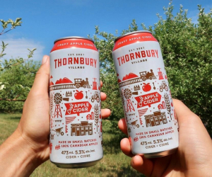 Two people cheers with Thornbury Premium Apple Cider